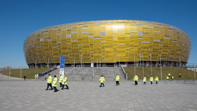 Stadium in Gdansk, Poland. GDANSK, POLAND - APRIL 05, 2014: Stadium PGE ARENA and stewards before match Polish Premier League between Lechia Gdansk - KGHM Stock Photography