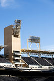 Stadium interior. With flood lights and seating against blue sky Stock Photos