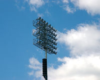 Stadium light. Lighting  in a stadium on a blue sky background Stock Photo