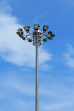 Stadium light pole on blue sky background Stock Photos