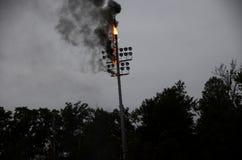 Stadium light pole on fire stock photography