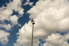 Stadium light pole with sky and clouds Stock Photography