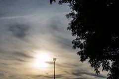 Stadium light pole with sunset Royalty Free Stock Image