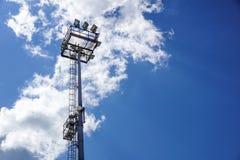 Stadium lighting pole light field at day bright blue Stock Image