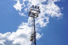 Stadium lighting pole light field at day bright blue Royalty Free Stock Image