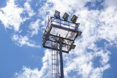 Stadium lighting pole light field at day bright blue Royalty Free Stock Photo