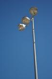Stadium lights. Lights at hockey rink under blue sky so lights are off stock photos