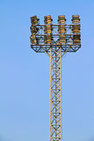 Stadium lights against a blue sky Stock Image