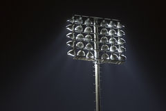 Stadium lights against dark night sky background Stock Image
