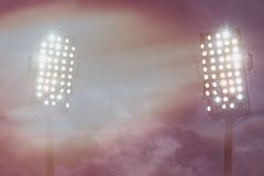 Stadium lights against dark night sky Stock Images