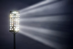 Stadium lights against dark night sky. Background Stock Image