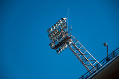 Stadium Lights and Blue Sky. Stadium lights set against a beautiful blue sky Royalty Free Stock Photos