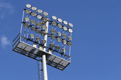 Stadium lights on a blue sky background Stock Image