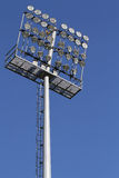 Stadium lights on a blue sky background Royalty Free Stock Images
