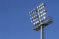 Stadium lights on a blue sky background Royalty Free Stock Photography