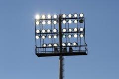 Stadium lights on a blue sky background Stock Photos