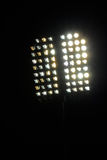 Stadium lights and dark blue sky Royalty Free Stock Image
