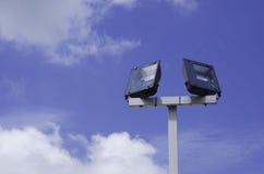 Stadium lights pole. Against blue sky background Stock Photo