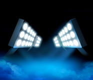 Stadium lights premiere. Stadium style lights illuminating blue surface premiere with color smoke stock illustration