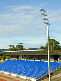 Stadium lights and seating Stock Images