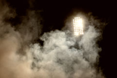 Stadium lights and smoke Royalty Free Stock Image