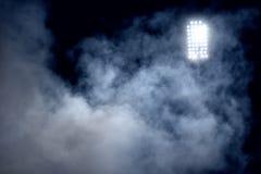 Stadium lights and smoke Stock Photography