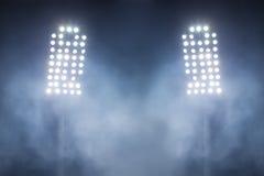 Stadium lights and smoke Royalty Free Stock Images