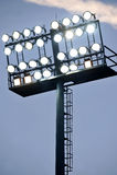 Stadium lights at sunset Stock Photo