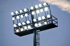 Stadium lights at sunset Stock Photos