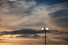 Stadium lights in sunset sky Royalty Free Stock Photo