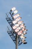 Stadium lights turn on at twilight time Royalty Free Stock Images
