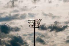 Stadium lights turn on twilight time Stock Images