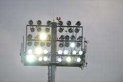 Stadium lights turned on. On a football field Stock Photos