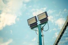 Stadium lights under blue sky with pastel tone Stock Photo