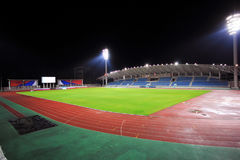 Stadium with bleachers in the night. Stadium at night with bleachers and a soccer field Royalty Free Stock Photos