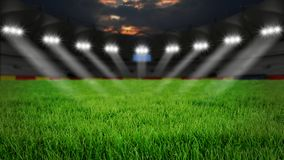 Stadium at night. Empty arena with green grass illumination at night royalty free stock images