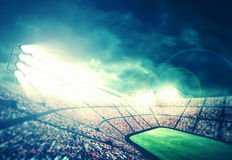 Stadium at night. The imaginary stadium is modelled and rendered Royalty Free Stock Photos