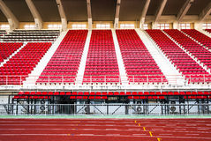 Stadium with red seats and red running track. Stock Photography