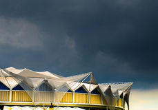 Stadium roof against sky. Stadium rooftop on a dark cloudy day Royalty Free Stock Photo