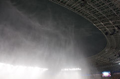 Stadium roof during a rain. Stadium - crowd of fans. The photo has taken during a soccer match: Uktaine-France on EURO 2012 Royalty Free Stock Image