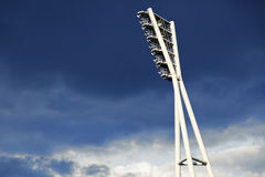 Stadium Lighting Tower and Cloudy Sky Stock Photography