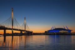 Stadium `Saint Petersburg Arena` on Krestovsky island and Cable-stayed bridge Western high-speed diameter across Peter`s fairwa. Y in St. Petersburg at sunset stock photos