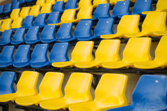 Stadium seat close up, yellow and blue Stock Images