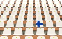Stadium seat with flag of finland. In a row of white chairs. 3D illustration Royalty Free Stock Images