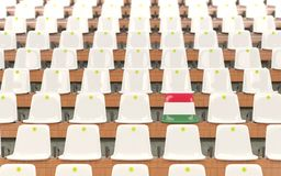 Stadium seat with flag of hungary. In a row of white chairs. 3D illustration Stock Image