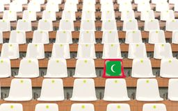 Stadium seat with flag of maldives. In a row of white chairs. 3D illustration Royalty Free Stock Images