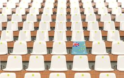 Stadium seat with flag of tuvalu. In a row of white chairs. 3D illustration Royalty Free Stock Photo
