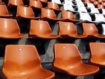 Stadium seat rows. Rows of orange and white seats in a stadium in Bangkok, Thailand Stock Photo