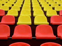 Stadium Seating. A row red and yellow seats stock images