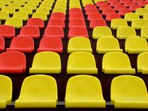 Stadium Seating. A row red and yellow seats royalty free stock photo